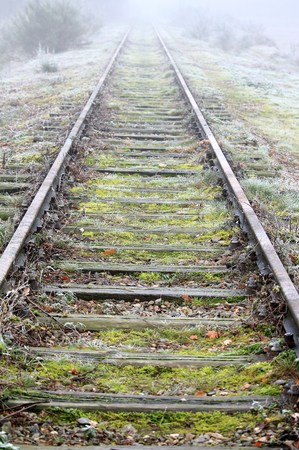Railroad track in the fog