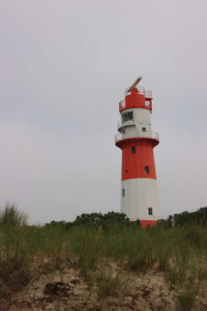 red lighthouse on the coast