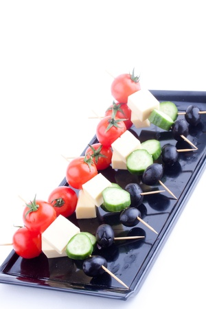cheese and olive canapes with tomato and cucumber photo