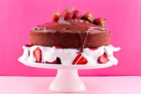 Chocolate cake with cream and strawberry photo
