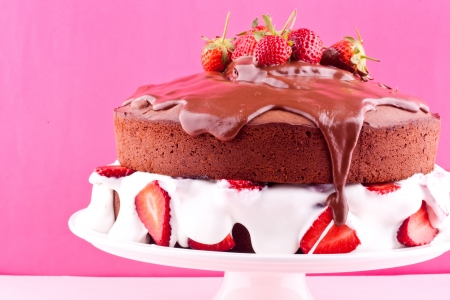 Chocolate cake with cream and strawberry photo