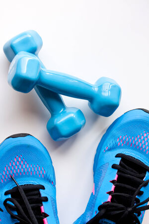 dumbbells and sport shoes photo