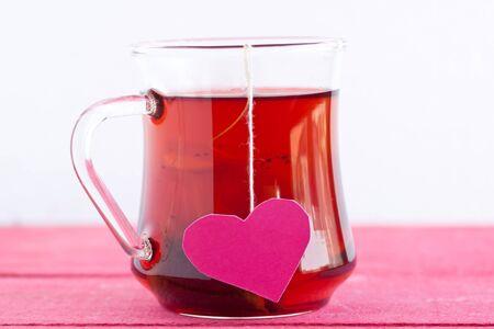 black tea with heart shaped tea bag