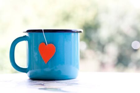 teabag: enamel mg with heart shape teabag Stock Photo
