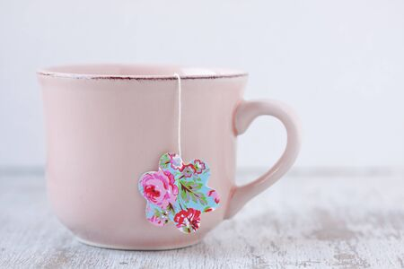 cup with flower shape teabag
