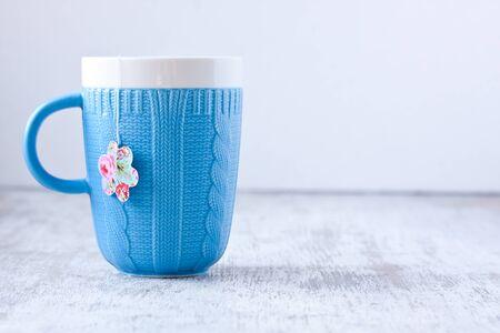 mug with flower shape teabag