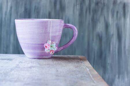 teabag: pink cup with teabag Stock Photo