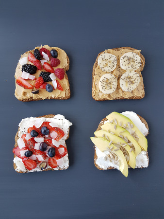sandwiches with peanut butter and cheese, banana, avocado, berries Stock Photo