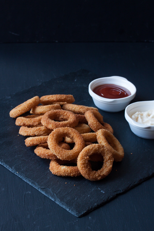 junk: Onion rings with mayonnaise and ketchup Stock Photo