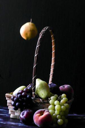 Still life fruits, plum grape, peach and pear Stock Photo