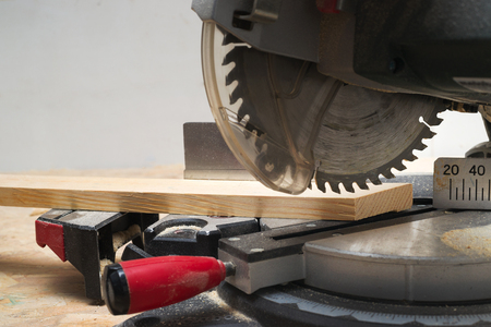 build buzz: Carpenter tools on wooden table with sawdust. Circular Saw. Copy space. Stock Photo