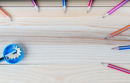 sharpened: Pencil sharpener shavings on a wooden table. Back to school. Copy space.
