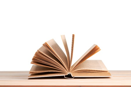 Open book isolated on wooden table. Back to school. Copy space.