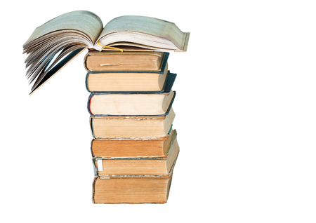 dictionary: Open book, stack of hardback books isolated on white background. Back to school. Copy space
