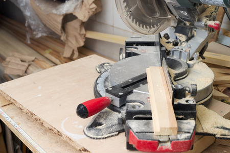 mitre: Carpenter tools on wooden table with sawdust. Circular Saw. Copy space. Stock Photo