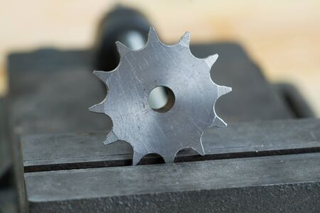 vice grip: The vise to clamp on a wooden desktop environment tools. Stock Photo