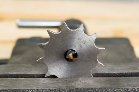 The vise to clamp on a wooden desktop environment tools. Stock Photo