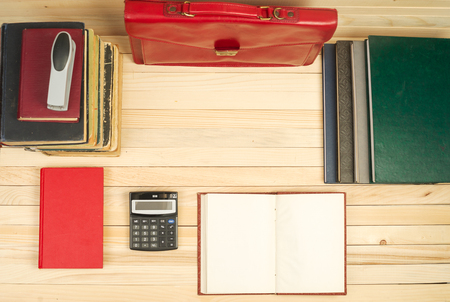 testament schreiben: Financial concept. On a wooden table books, documents, calculator, red briefcase. Copy space