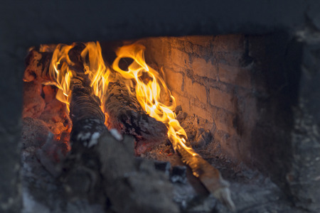 smolder: firewood in hot stove and streamer Stock Photo