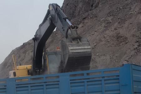 Excavator loading dumper truck tipper in construction site Khao kho Phetchaboon photo
