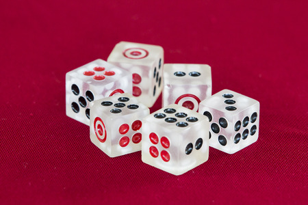Six transparent dice on a red felt Stock Photo