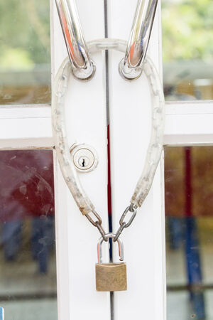 Aluminum door lock with chain in a day photo