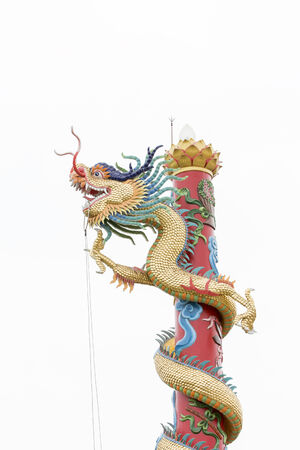 Golden dragon statue on pole in Chinese style at uthaitani thailand photo