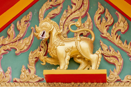 role model: Gold Singha in the temple Thailand Stock Photo