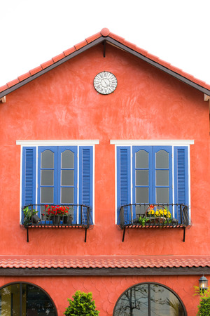Decorative blue window on an old red  stucco wall. photo