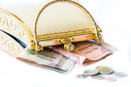 vanity bag: Golden clutch and money ,closeup, on a white background