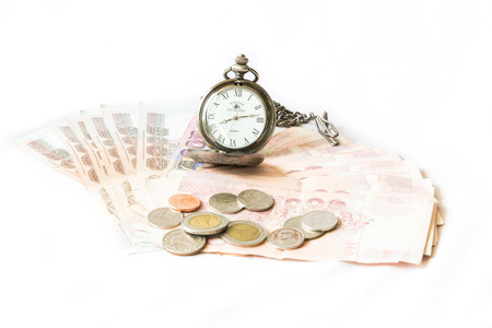 Money and vintage pocket watch ,Time and financial concept. photo