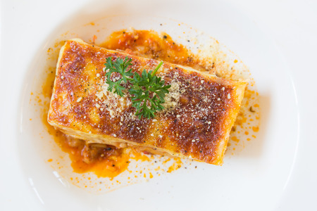 A Piece of pork and tuna Lasagna, close up. photo