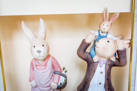3 Rabbit doll family made from plaster. photo