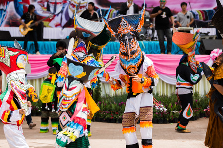 LOEI ,THAILAND-JUNE 28: Ghost Festival Phi Ta Khon. The mask procession celebrated in Thailand, The Thai Buddhist ceremony at Dansai district Loei province, on June 28,2014.