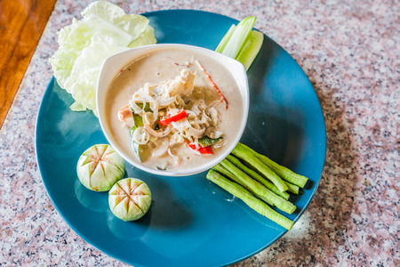 lon: Thai style salted crab in Coconut Milk served with Fresh Vegetables,Lon Phu Kem. Stock Photo