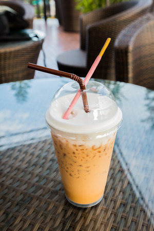 poky: Iced coffee with straw and Pocky in plastic cup Stock Photo