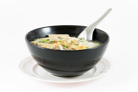 Bowl of Vietnamese noodle soup served with onions and cilantro,pho bo. photo