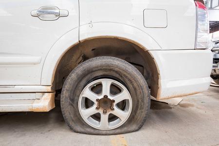 flat tyre: flat tyre on car wheel