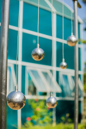 newtons cradle: Newtons cradle model in park Nhong na ri Phetchaboon. Stock Photo
