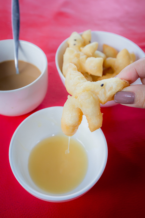 patongkoh: Deep-fried dough stick Chinese flour sweetmeat with Sweetened Condensed Milk.