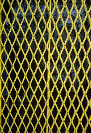 welded: Yellow steel grating over water.