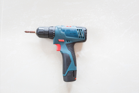 power wrench: Little green electric drill. perforator.