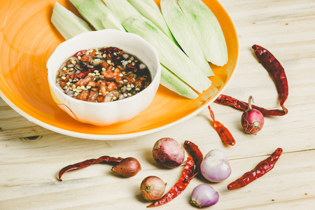 fresh taste: Sour taste with green of fresh mangoes and sweet fish sauce and spices of Thai snack. Stock Photo