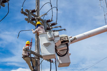 electrician repair the high voltage transmission system.