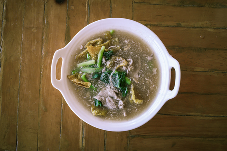 The Best Thai Dishes, Wide Rice Noodles Pork in Thick Gravy, Thai Noodles Topped with Pork: Chinese and Thai Style food called Rad Na Stock Photo