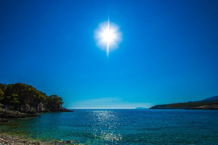 shining sun on the beach in blue photo
