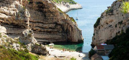 Scenic landscape about Stiniva bay in vis island photo