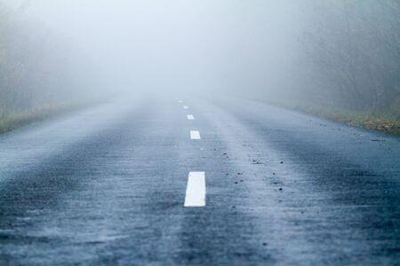 Asphalt road in an autumn fog Stock Photo - 17016685