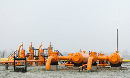 orange gas pipe in frosted winter photo