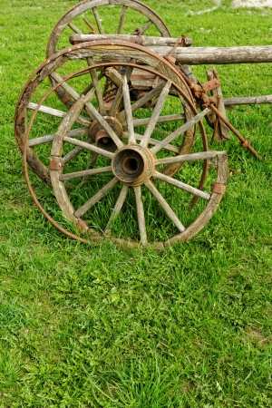 old broken wooden wheel spokes, side by chariot photo